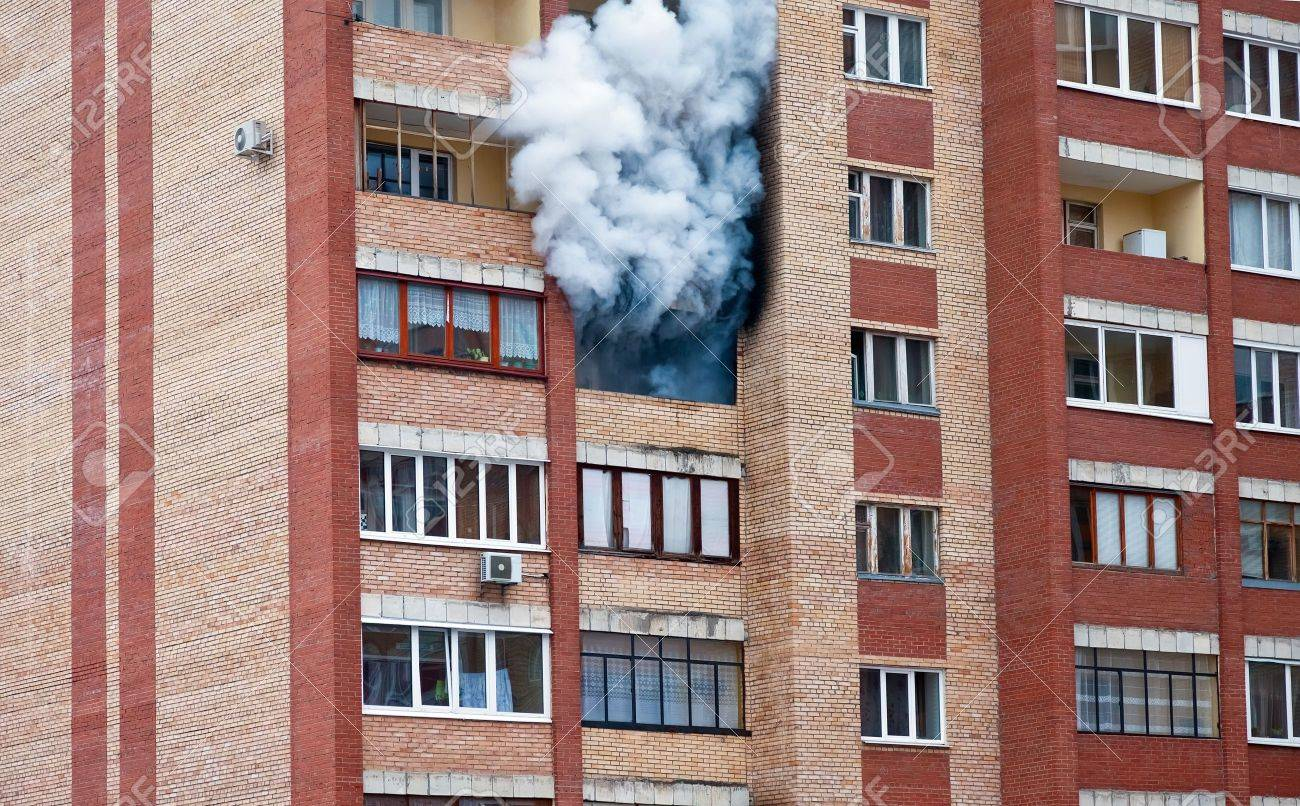 Fire in one of the apartments of a large tenement-house - 13096905