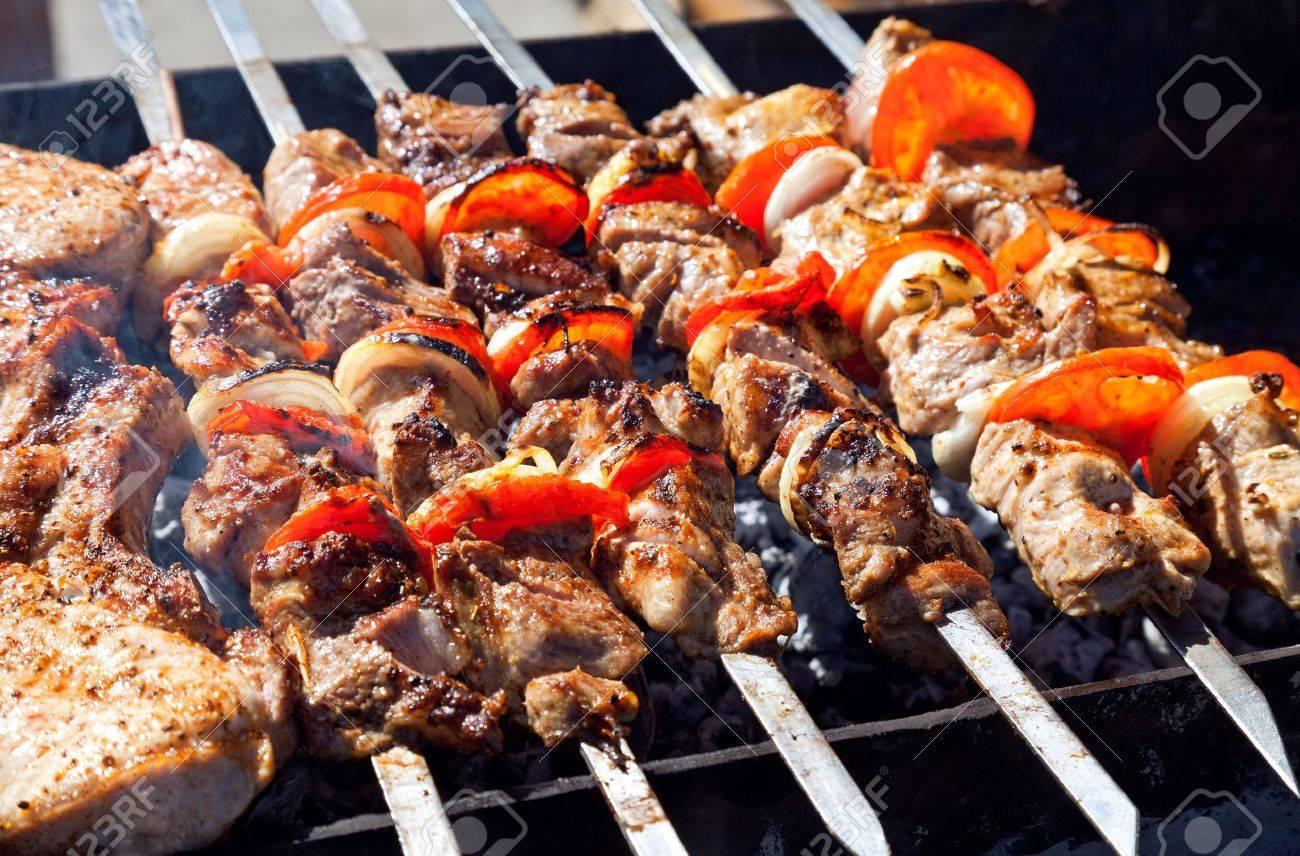 Appetizing fresh meat shish kebab shashlik prepared on a grill wood coal, outdor - 13293022