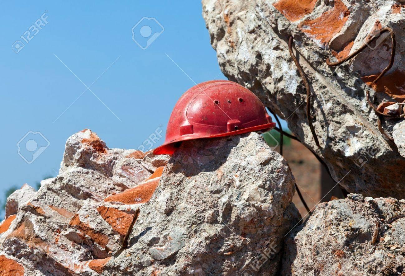 Old construction helmet over ruins - 13606324