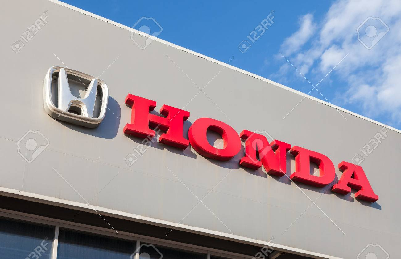 SAMARA, RUSSIA - AUGUST 30, 2014: Honda dealership sign against blue sky. Honda Motor Co., Ltd. is a Japanese public multinational corporation known as a manufacturer of automobiles, motorcycles and power equipment - 31343327