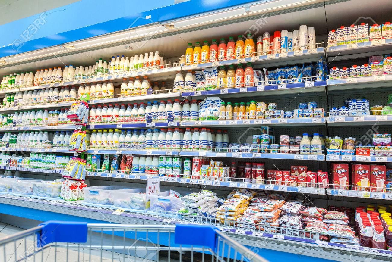 SAMARA, RUSSIA - FEBRUARY 7, 2015: Fresh milk produces ready for sale in Perekrestok Samara Store. Perekrestok is a Russian supermarket chain operated by X5 Retail Group - 36397312