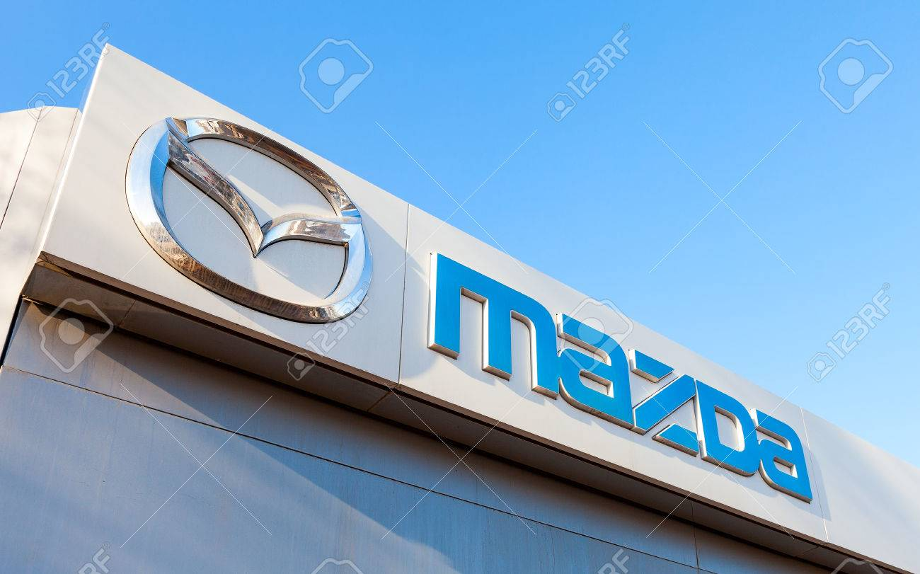 SAMARA, RUSSIA - FEBRUARY 20, 2016: Official dealership sign of Mazda. Mazda Motor Corporation is a Japanese automaker - 52927312
