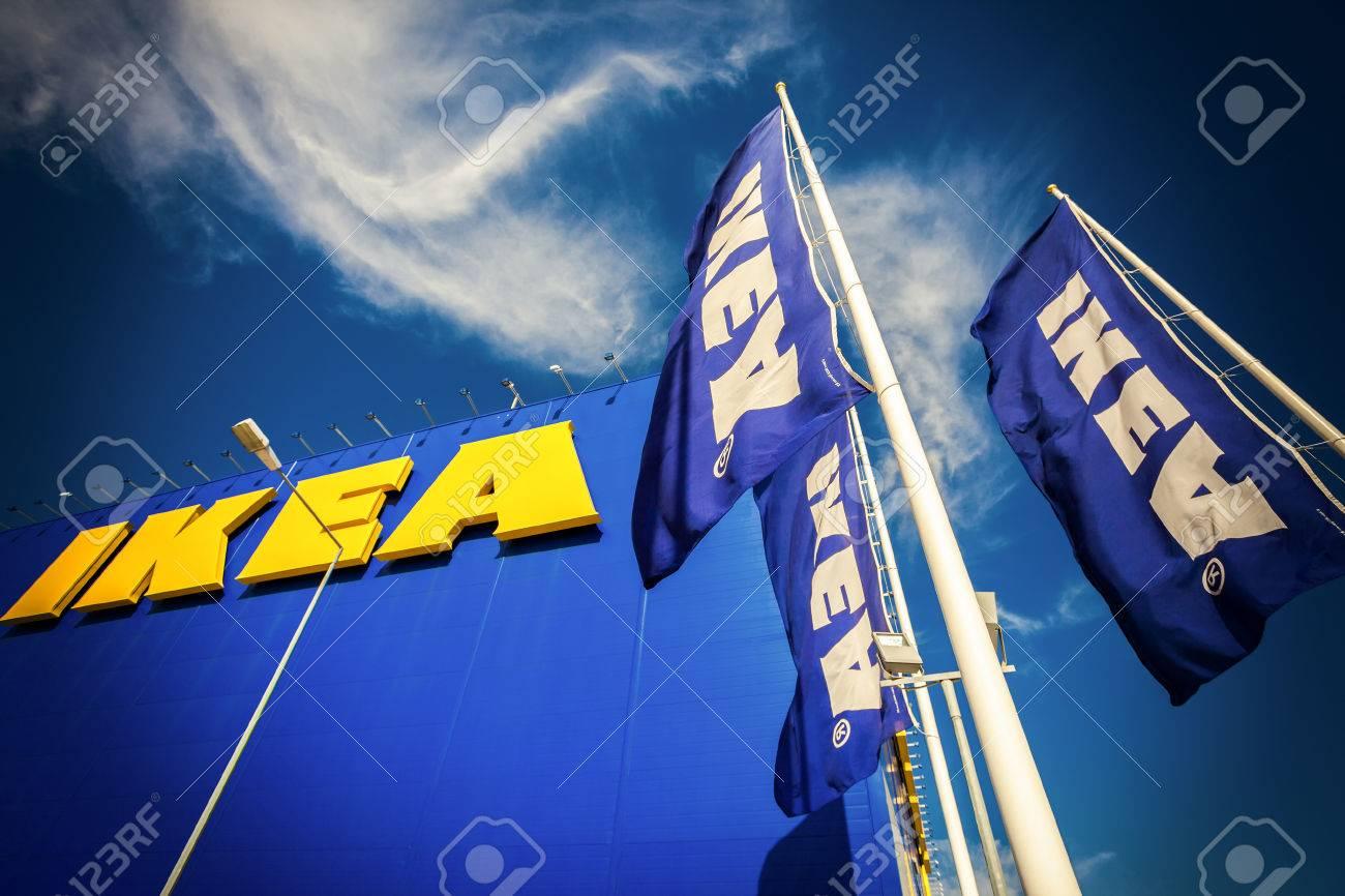 SAMARA, RUSSIA - SEPTEMBER 9, 2015: IKEA flags against sky at the IKEA Samara Store. IKEA is the world's largest furniture retailer - 63615473