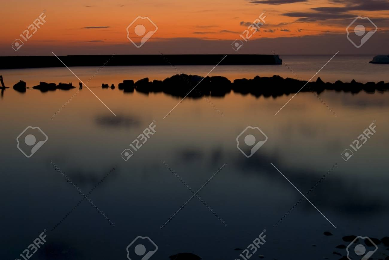Beautiful sunrise In Kivik, colorful sky and calm water Stock Photo - 15450205
