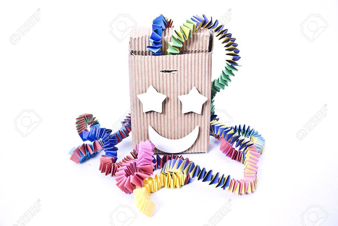 A box devil is toys which looks from the outside like a box with a crank. If one turns these, he plays a melody (often pop goes the Weasel). At the end of the melody the box jumps up and a figure  mostly a clown  on a spring jumps out. In the English la Stock Photo - 5477249