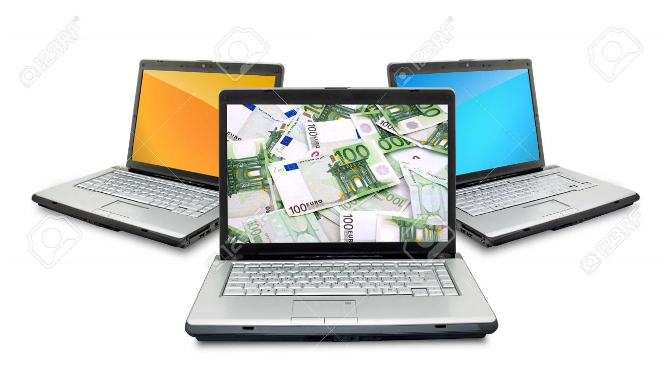Open laptops with money  isolated on white background Stock Photo - 6175910