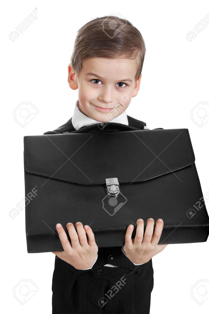 Boy holding a briefcase isolated on white background Stock Photo - 6597890