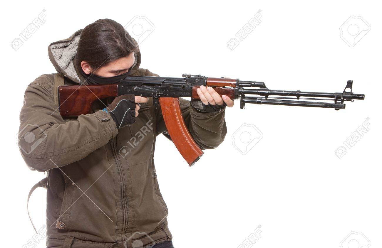 Terrorist with weapon on a white background Stock Photo - 7493428