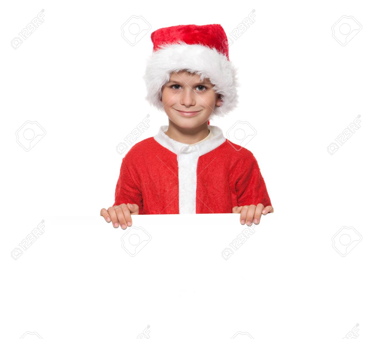 Boy holding a christmas poster isolated on white background Stock Photo - 7853301