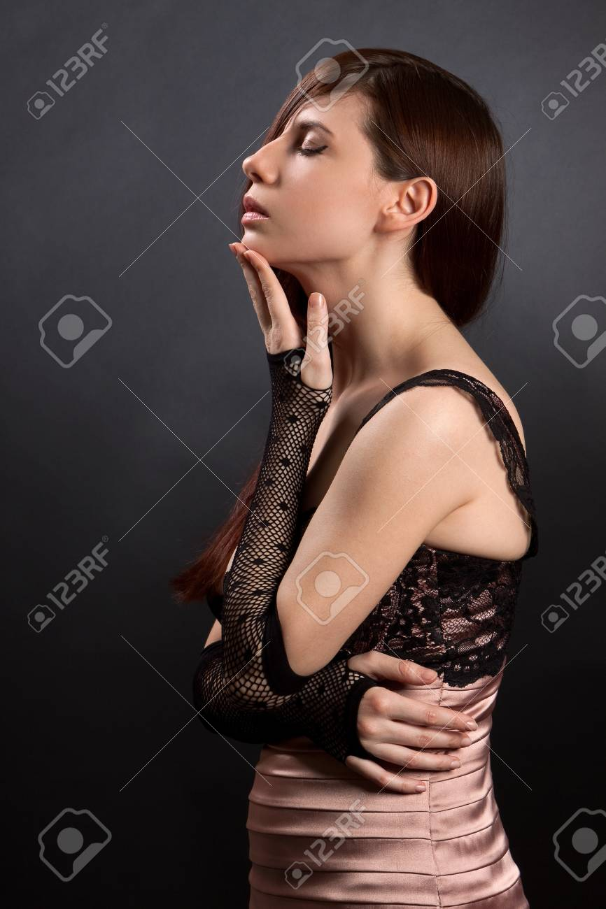 Sexy woman on a black background. Shot in a studio Stock Photo - 9375000