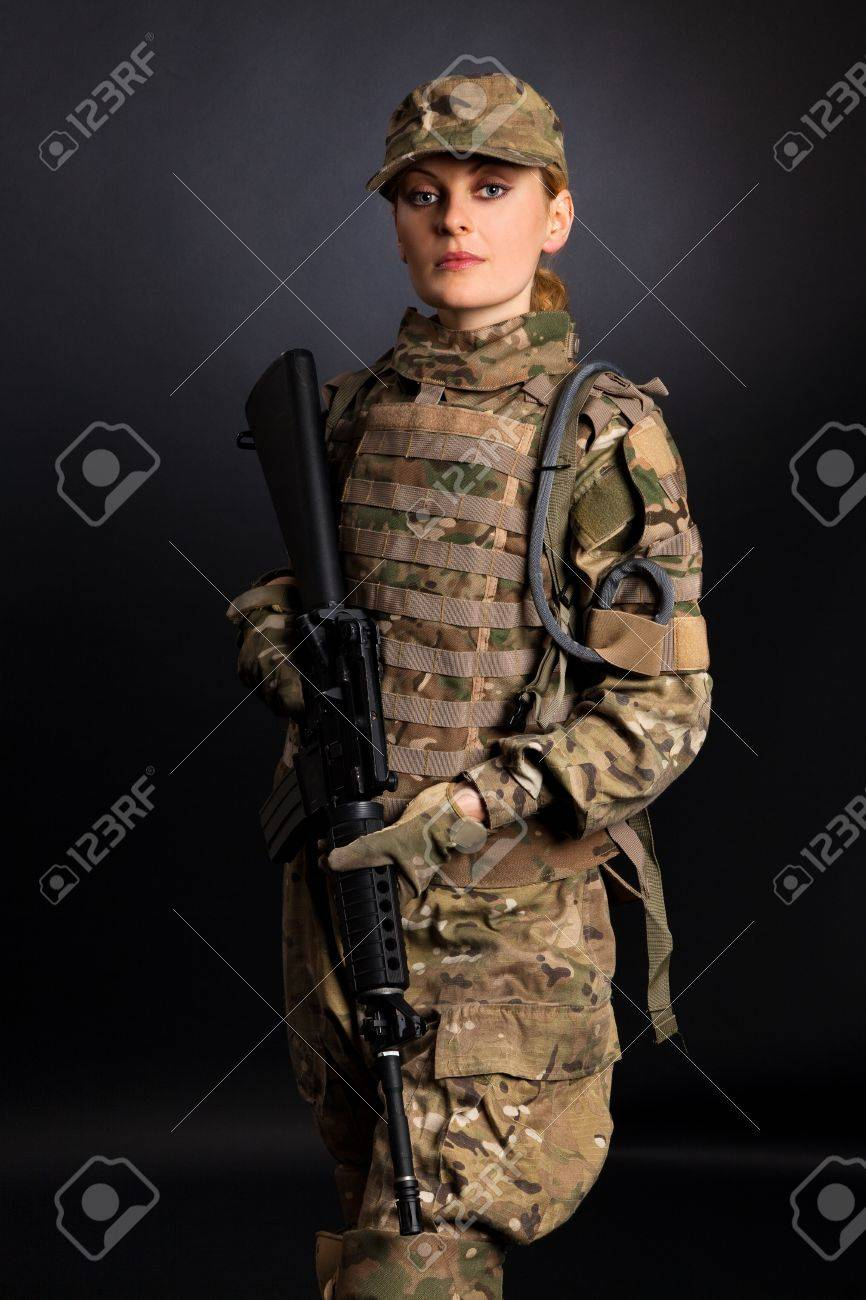 Beautiful army girl with rifle isolated on black Stock Photo - 11004089