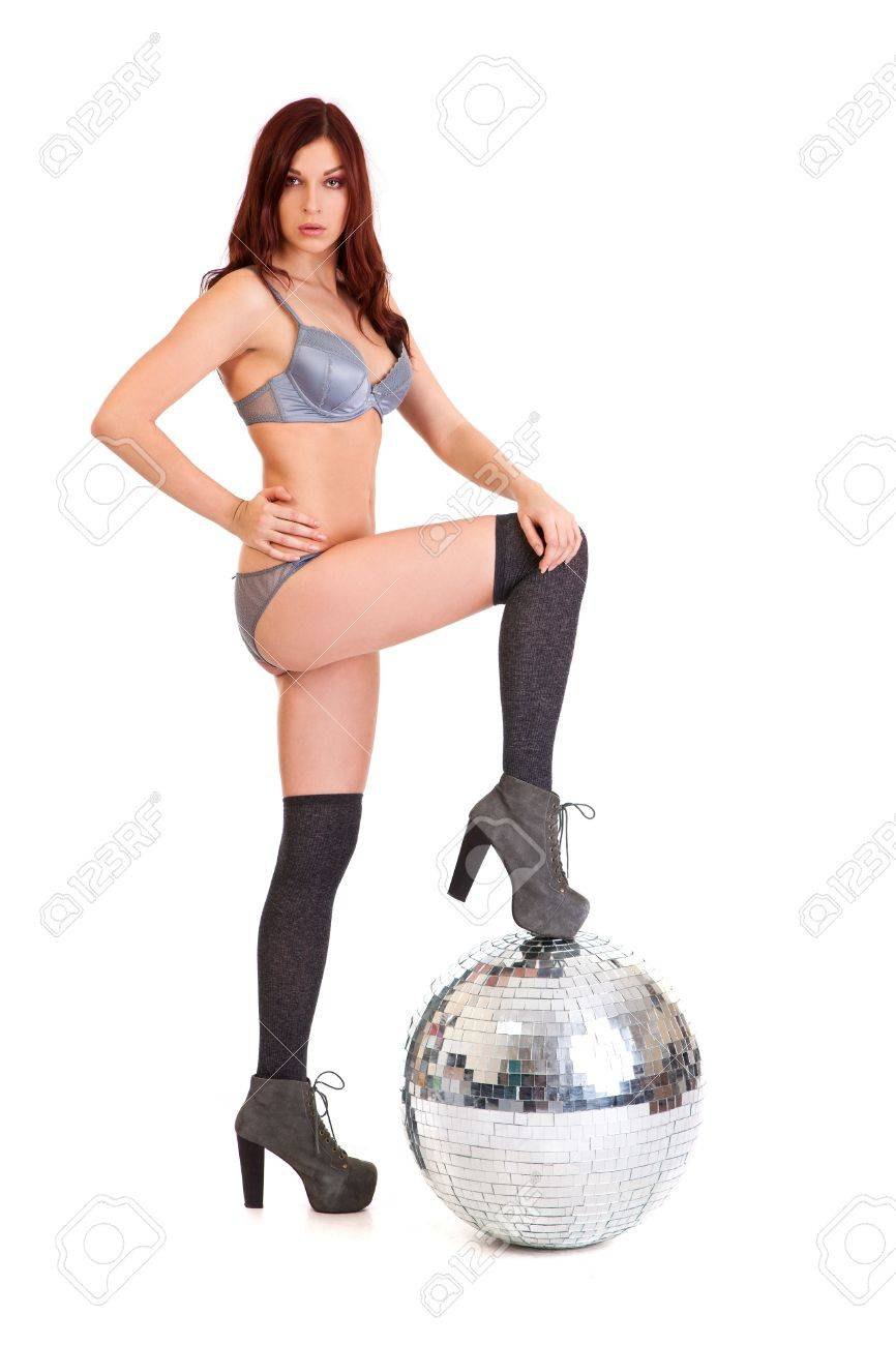 Party dancer on high heels with disco ball isolated on white background Stock Photo - 11071675