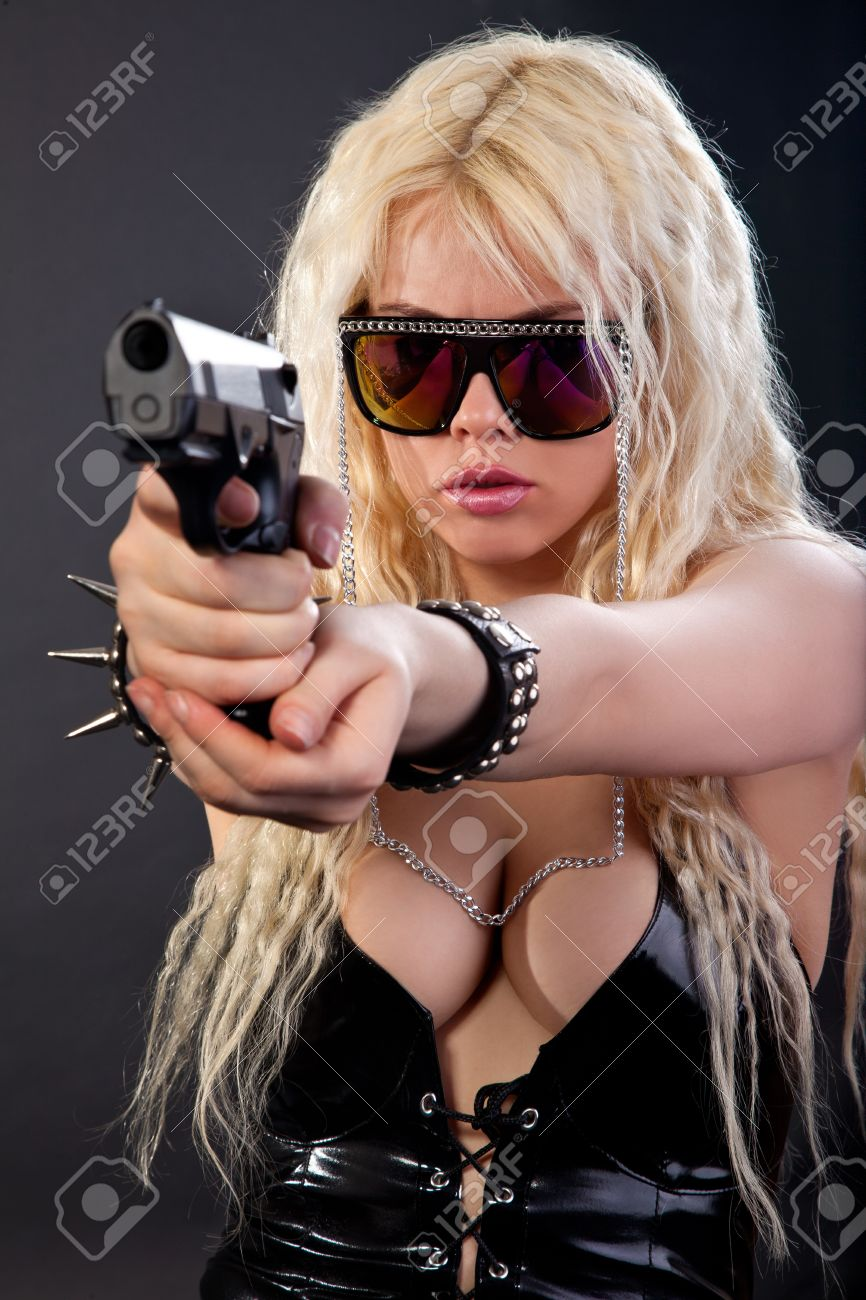 Beautiful sexy girl with gun isolated on black background Stock Photo - 13858428