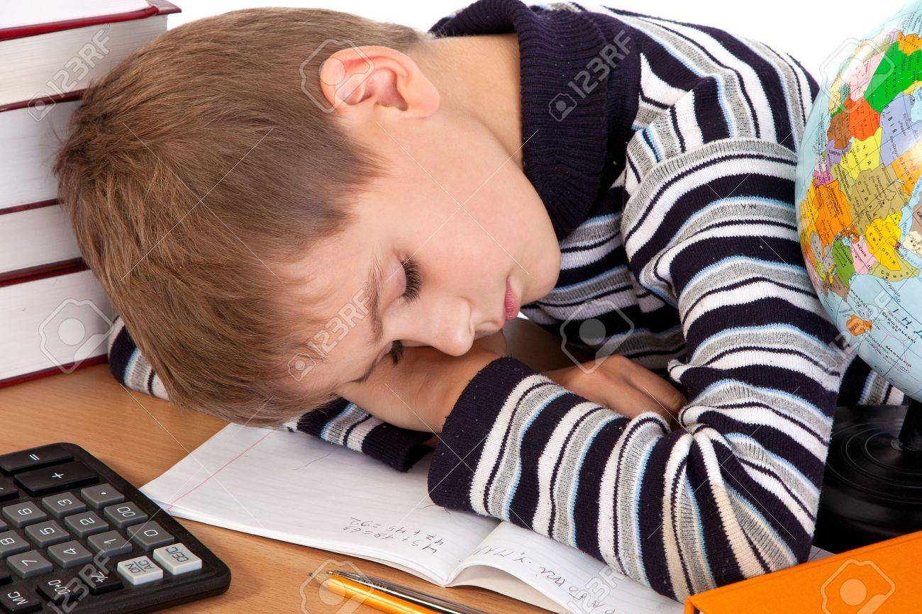 Tired schoolboy isolated on a white background Stock Photo - 14021992