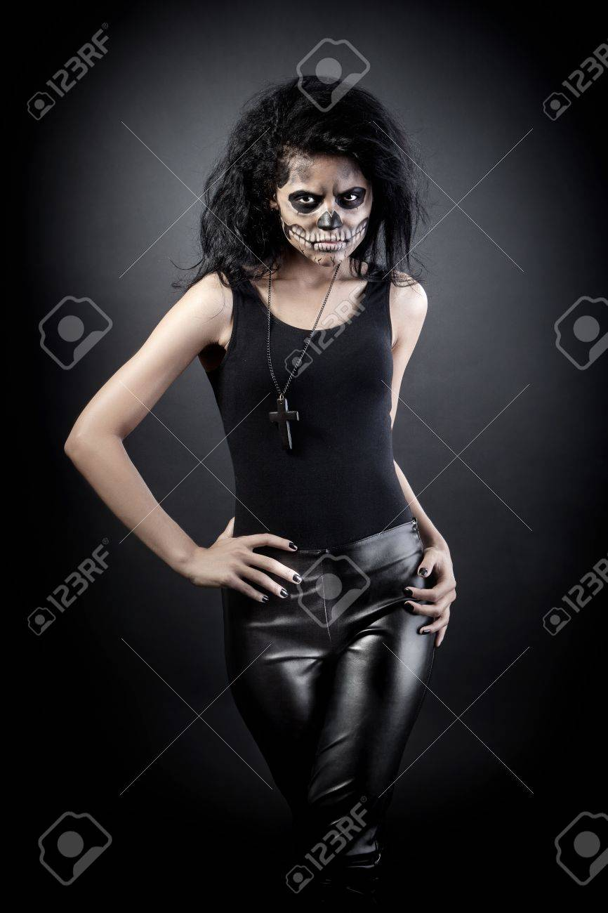 Young woman in day of the dead mask skull face art. Halloween face art with fog on black background Stock Photo - 15237984