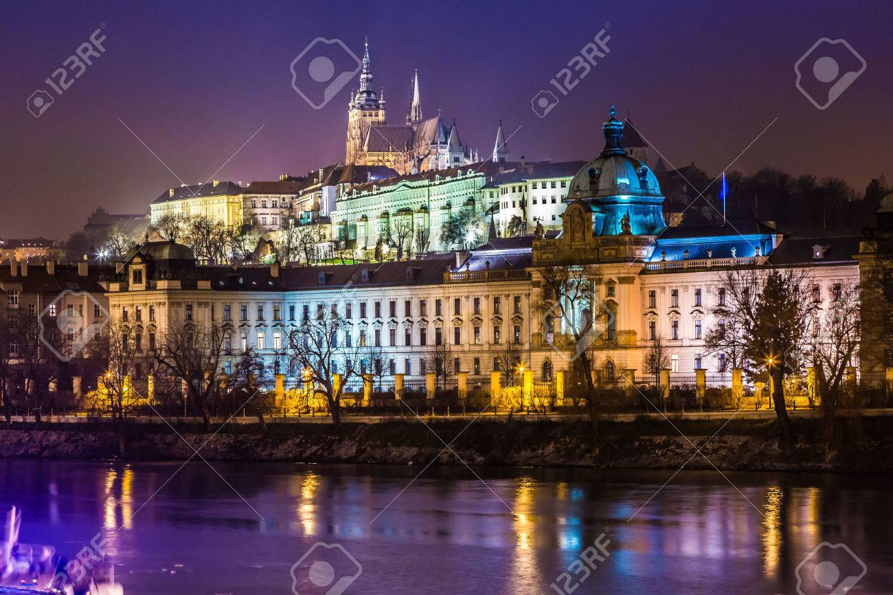 The View On Prague Gothic Castle With Charles Bridge In Night