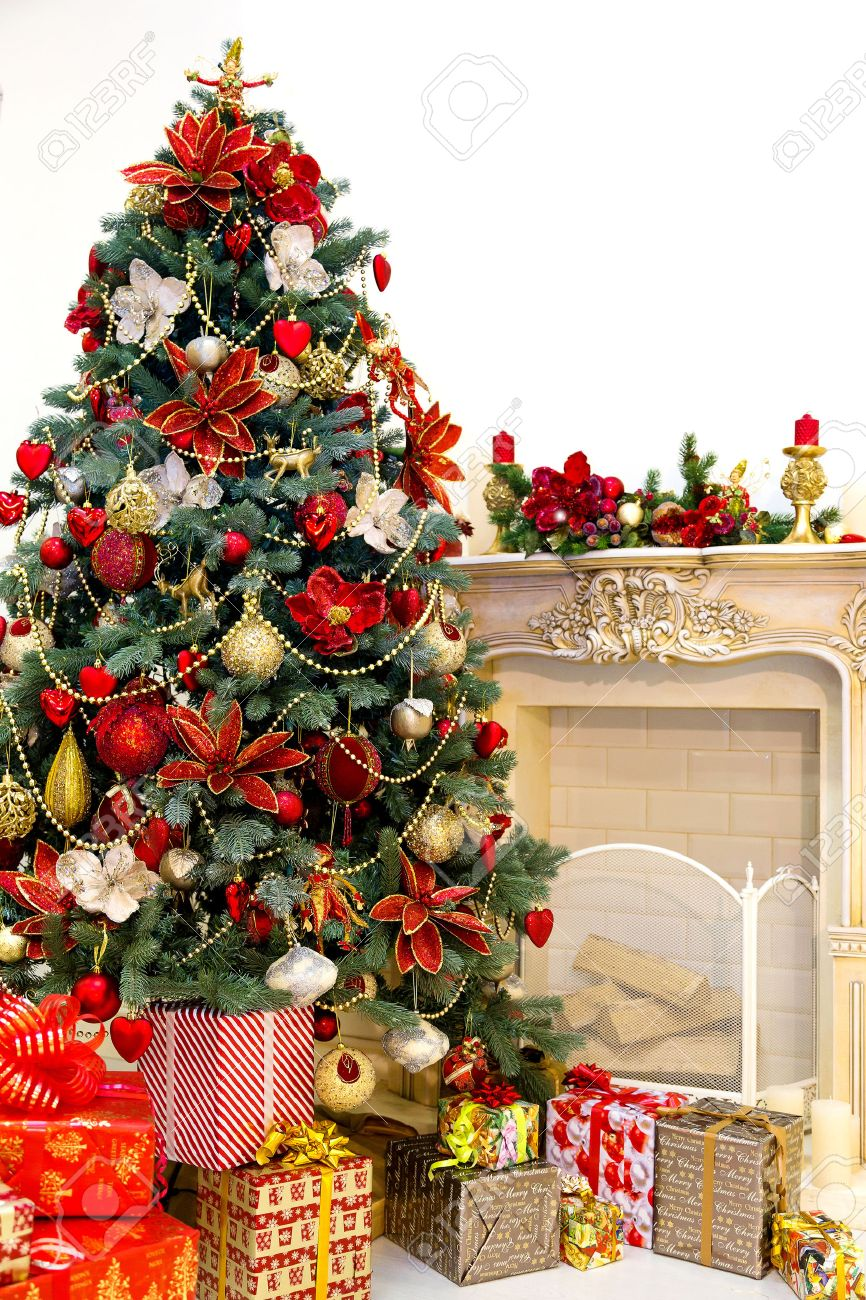 decorated christmas tree and gift boxes in living room stock photo 23784477