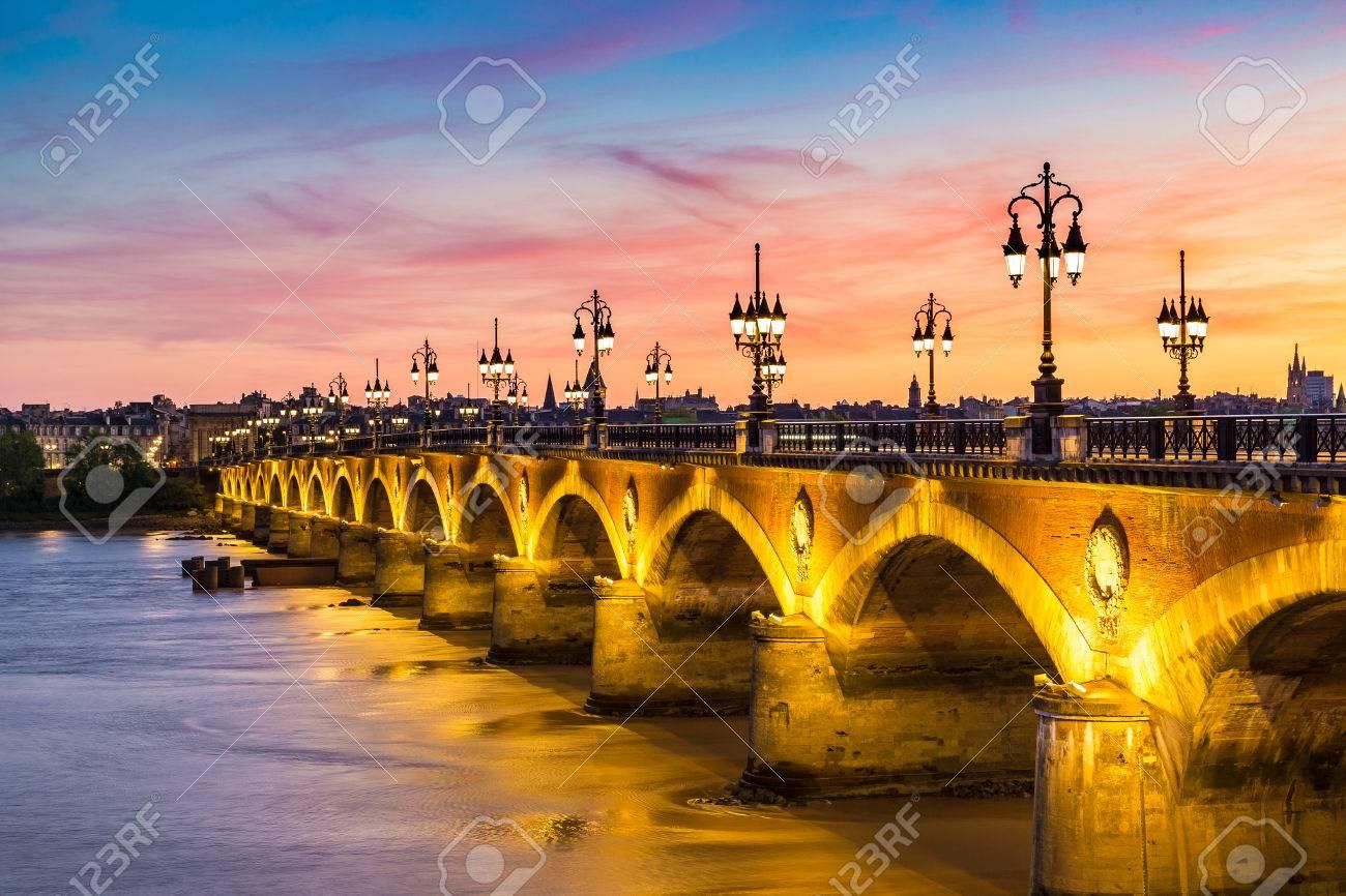Pont de pierre, old stony bridge in Bordeaux in a beautiful summer night, France - 70645233