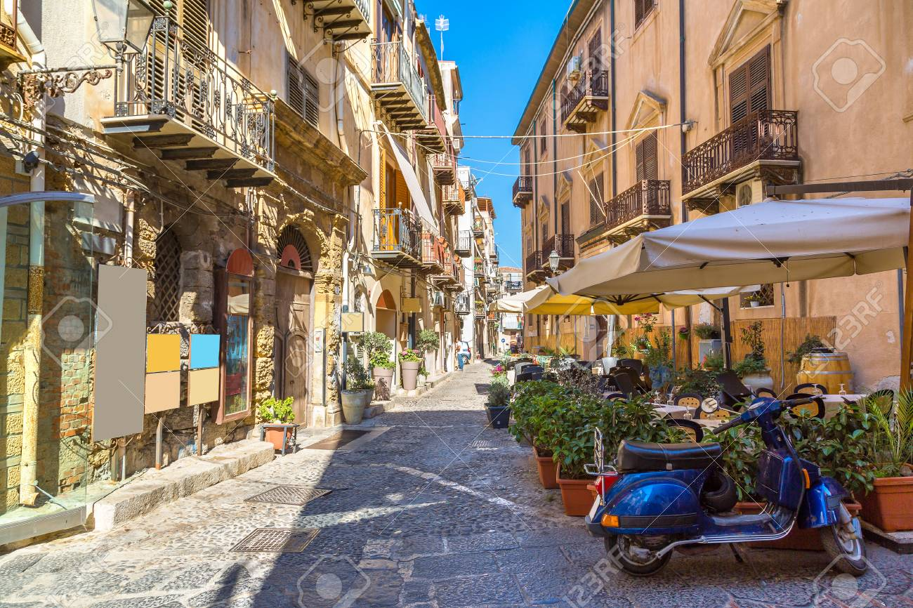 Narrow street in the old town of Cefalu in Sicily, Italy in a beautiful summer day - 84958035