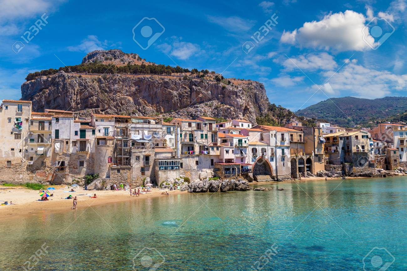 Harbor and old houses in Cefalu in Sicily, Italy in a beautiful summer day - 85007599