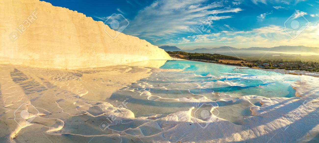Travertine pools and terraces in Pamukkale, Turkey in a beautiful summer day - 90097616