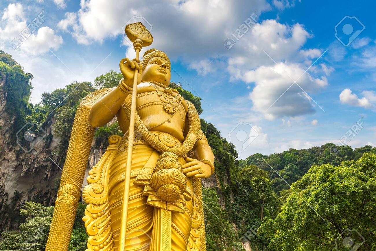 Statue of hindu god Murugan at Batu cave in Kuala Lumpur, Malaysia at summer day - 122947685