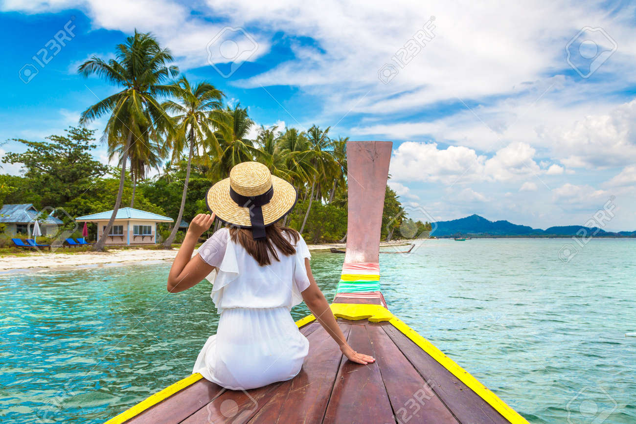 Happy traveler woman relaxing on boat near tropical island in Thailand - 173329227