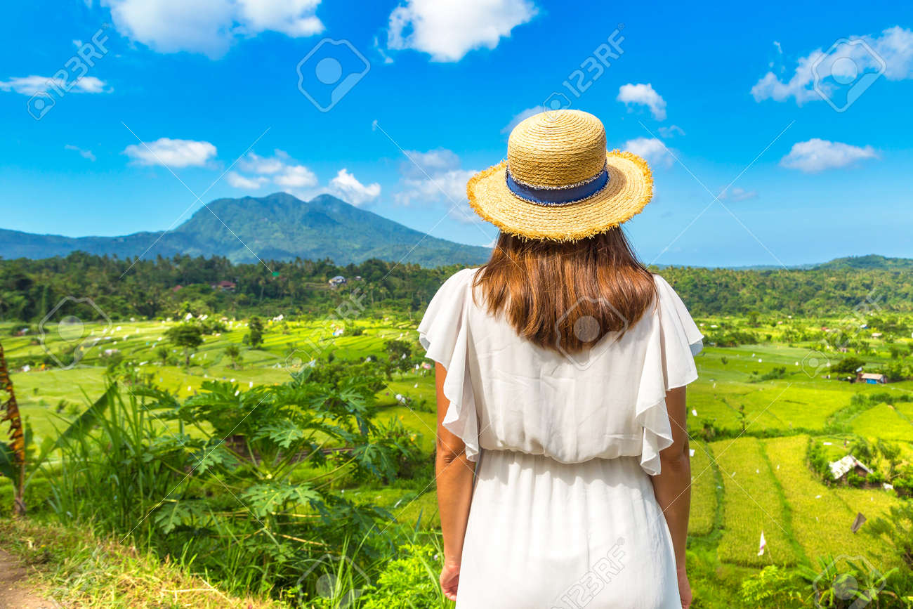 Woman traveler at Panoramic view of Rice terrace field on Bali, Indonesia in a sunny day - 173329355