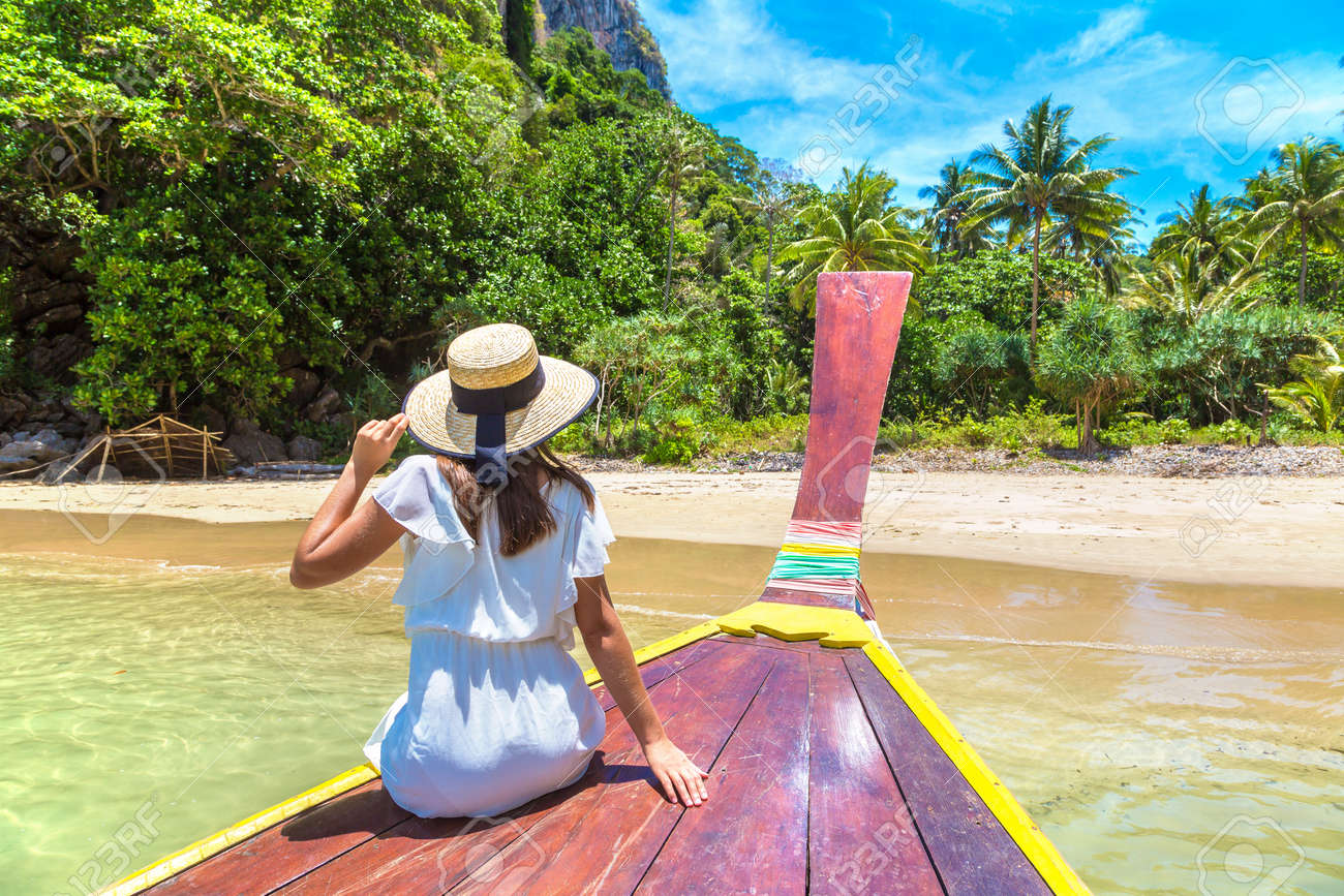 Happy traveler woman relaxing on boat near tropical island in Thailand - 173329833