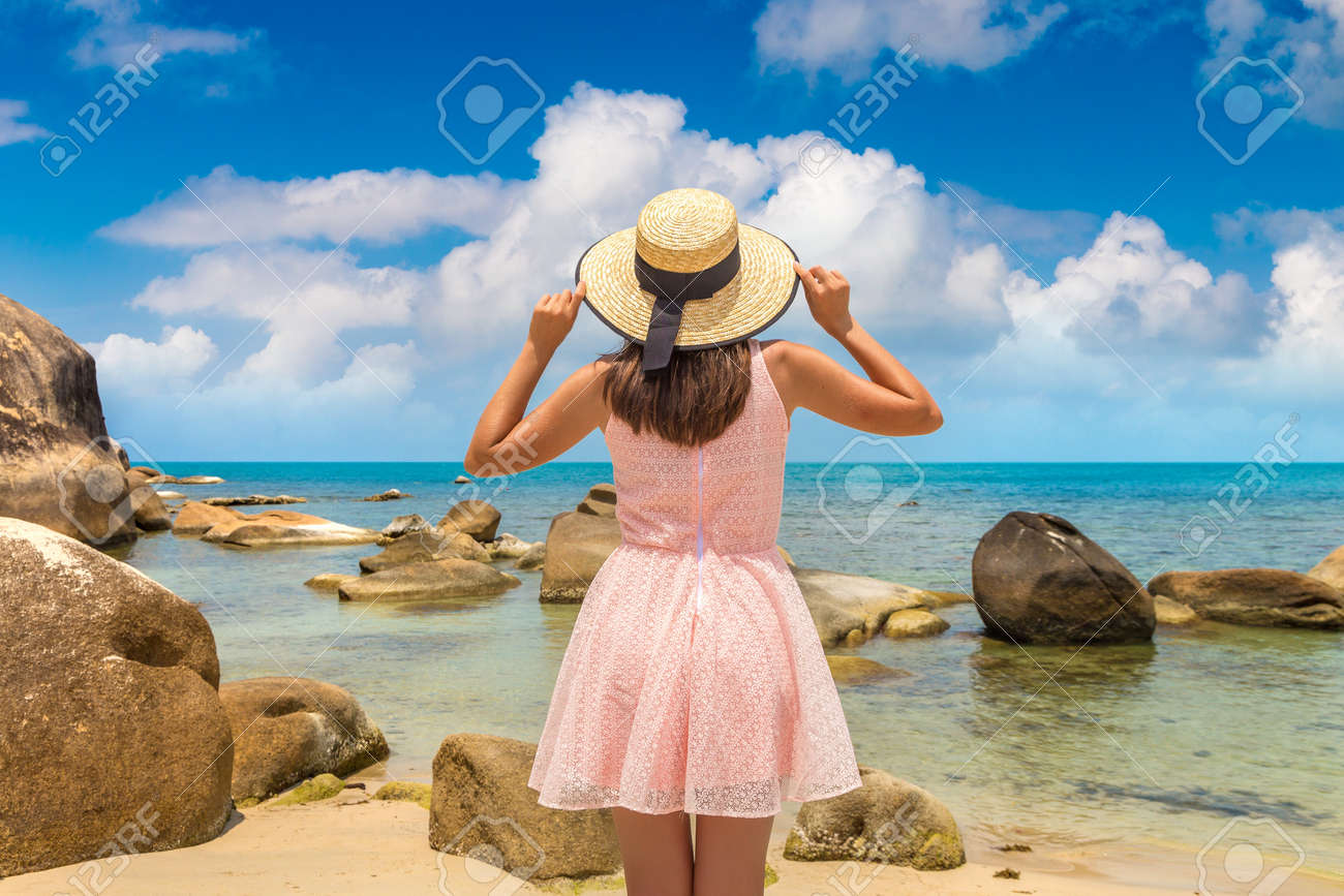 Woman traveler wearing pink dress and straw hat at Silver Beach on Koh Samui island, Thailand in a summer day - 173329840