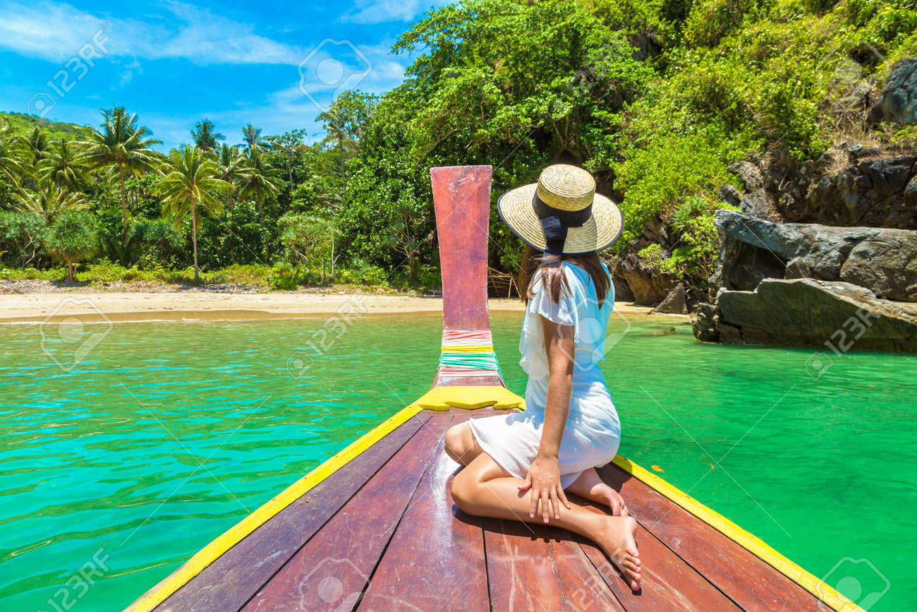 Happy traveler woman relaxing on boat near tropical island in Thailand - 173329887