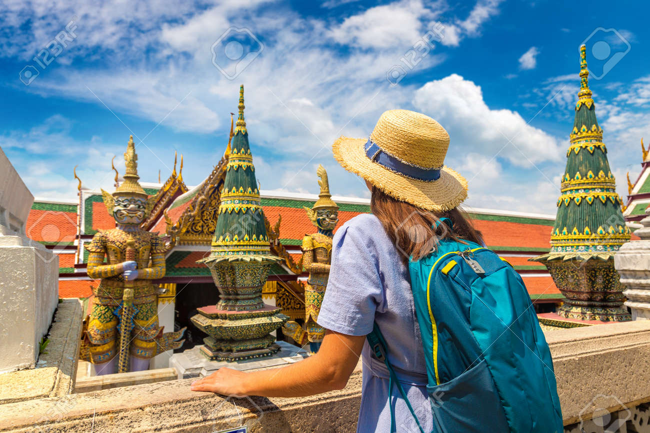 Woman traveler at Demon Guardian in Wat Phra Kaew (Temple of the Emerald Buddha), Grand Palace in Bangkok in a summer day - 173330167