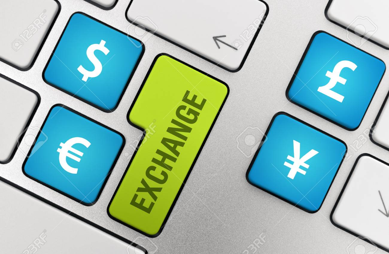 Exchange with symbols of the world major currencies on a modern aluminium keyboard. Stock Photo - 9830725