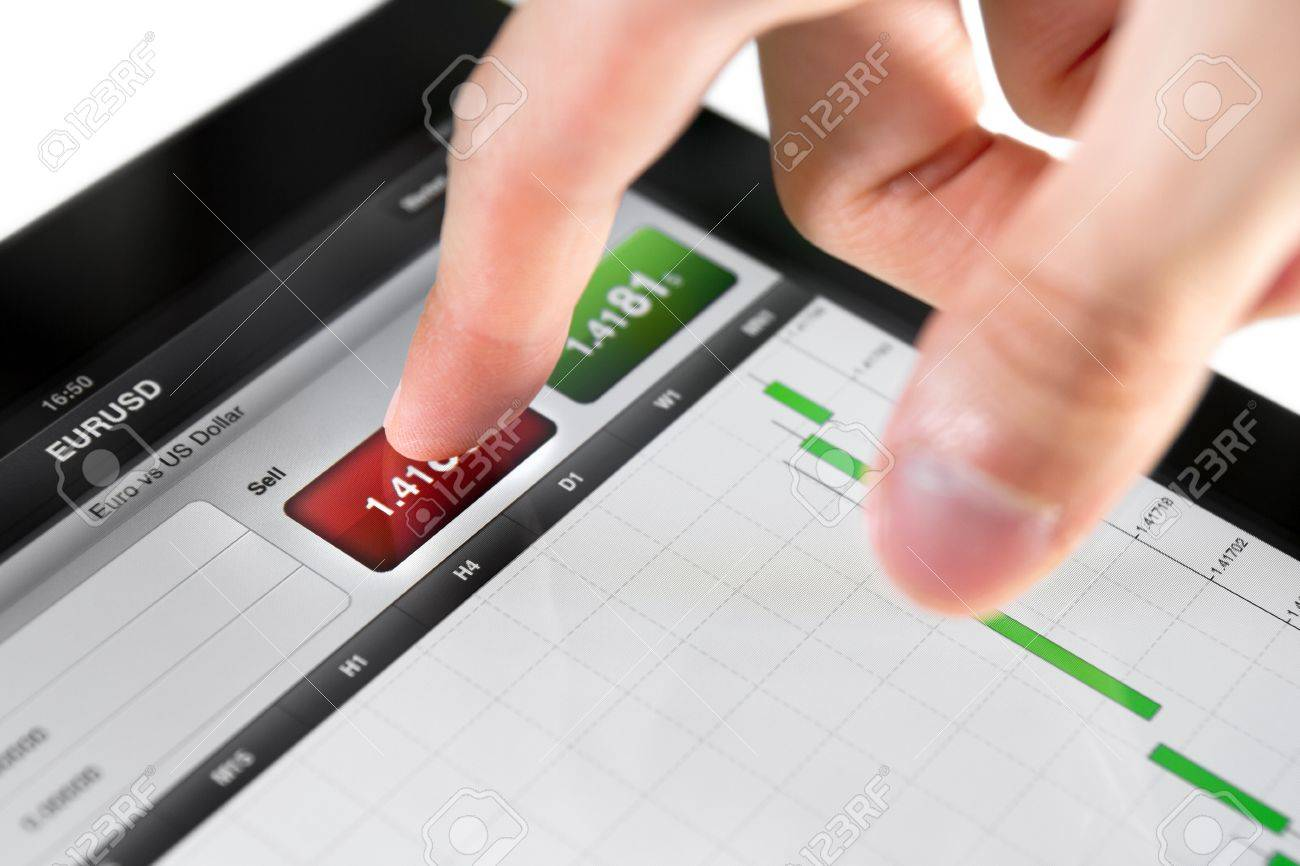 Touching sell button on stock market EUR/USD pair on a touch screen device. Stock Photo - 9830728