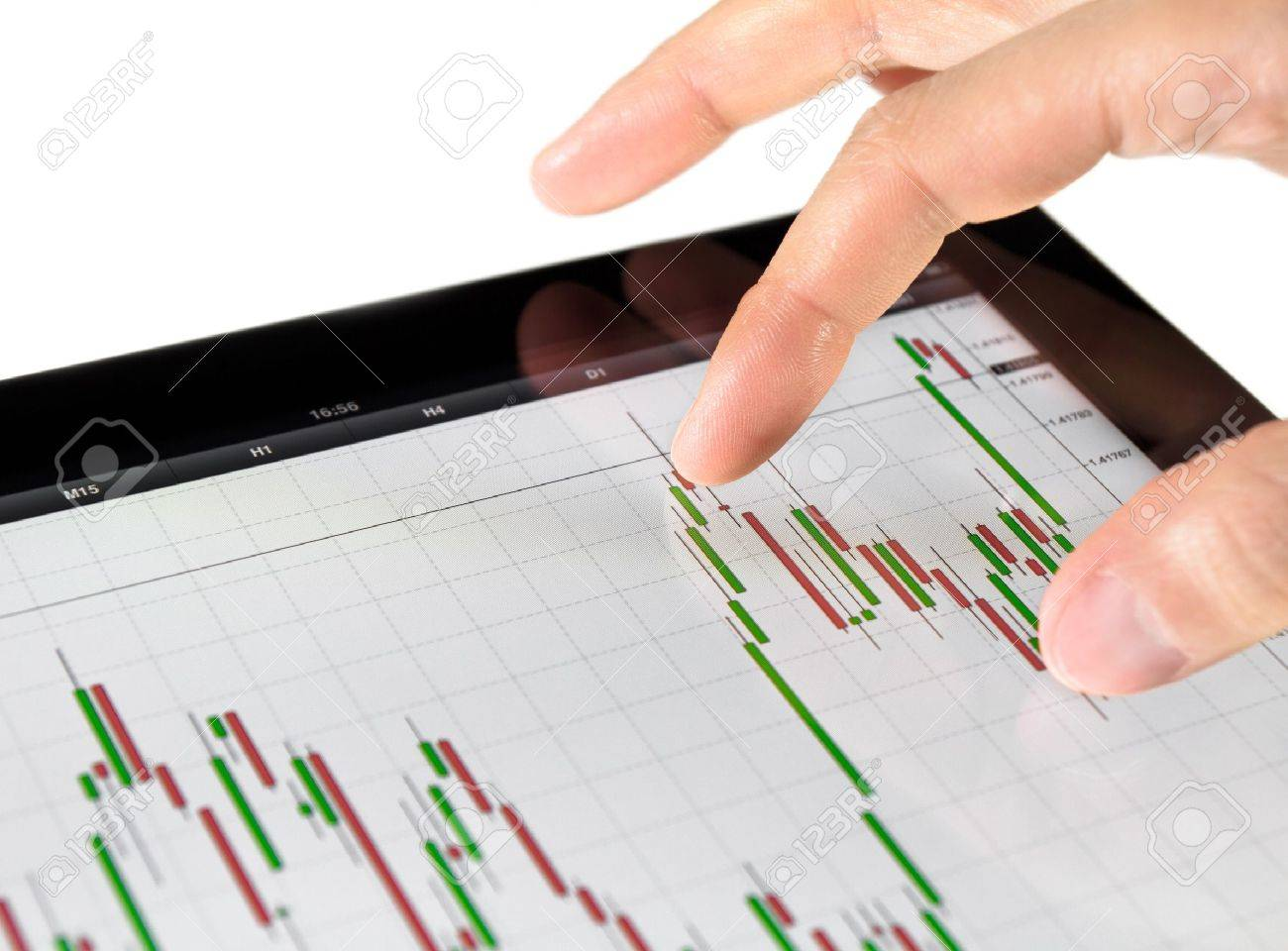 Using touch screen tablet for analyzing stock market chart. Stock Photo - 9830732
