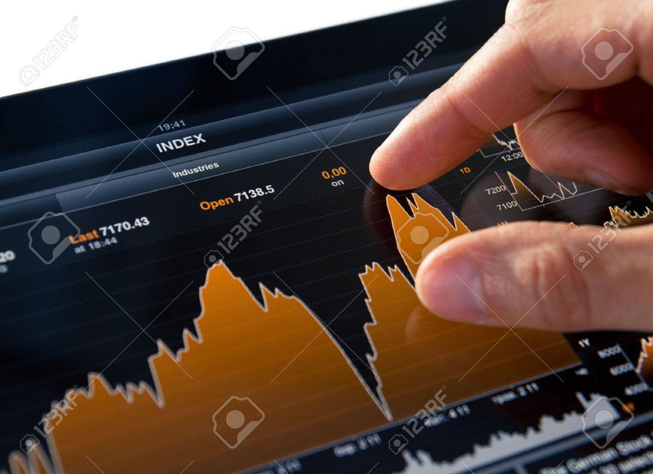 Analyzing stock market graph on a touch screen device. Stock Photo - 9830734