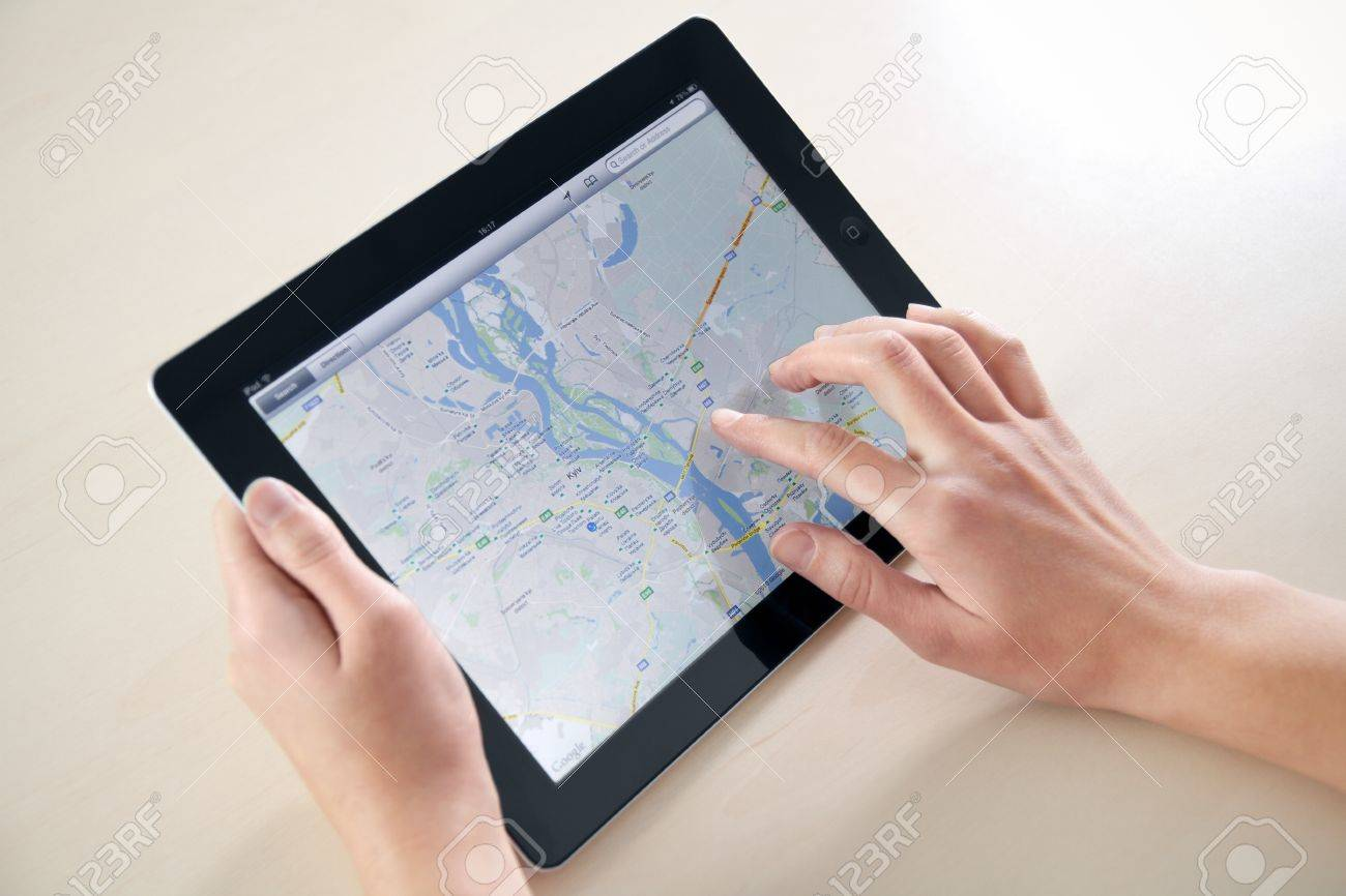 Kiev, Ukraine - December 03, 2011: Woman hands holding and touching on Apple iPad2 with Google Maps application on a screen. This second generation Apple iPad2 is designed and development by Apple inc. and launched in march 2011. Stock Photo - 11652147