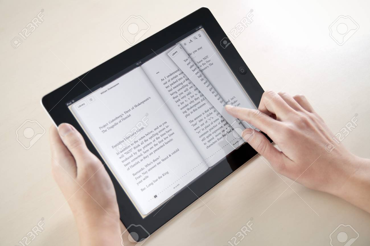 Kiev, Ukraine - December 03, 2011: Woman reading William Shakespeare poetry on Apple iPad2. This second generation Apple iPad2 is designed and development by Apple inc. and launched in march 2011. Stock Photo - 11652145