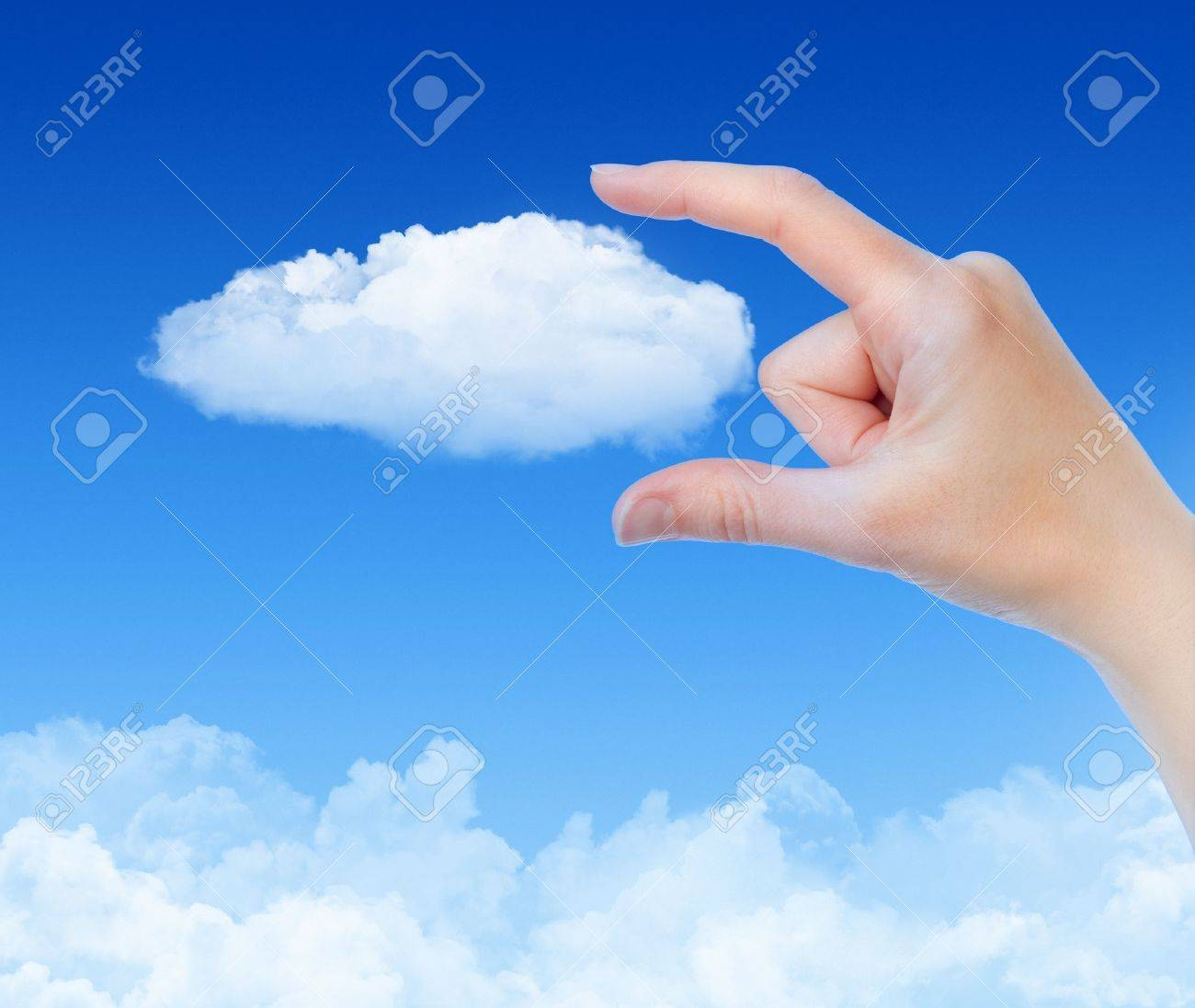 Woman hand measures the cloud against blue sky with clouds. Concept image on cloud computing and eco theme. Stock Photo - 11978135