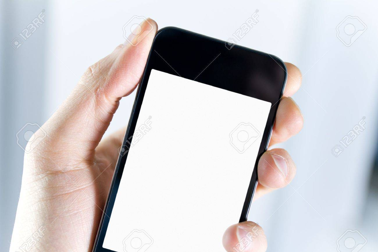 A man holding smartphone with blank screen in hand. Closeup shot. Stock Photo - 12449124