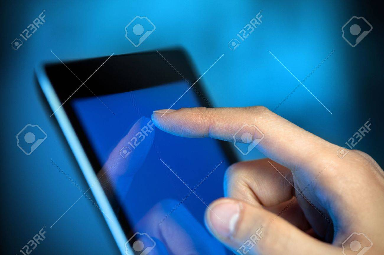 Man hand touching screen on modern digital tablet pc  Close-up image with shallow depth of field focus on finger Stock Photo - 12449120