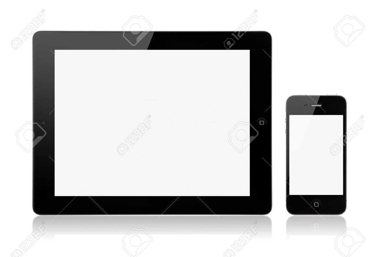 Kiev, Ukraine - Marth 23, 2012 - A new Apple iPad 3rd generation with Apple iPhone 4S on a white background with a blank screen. Stock Photo - 13111805
