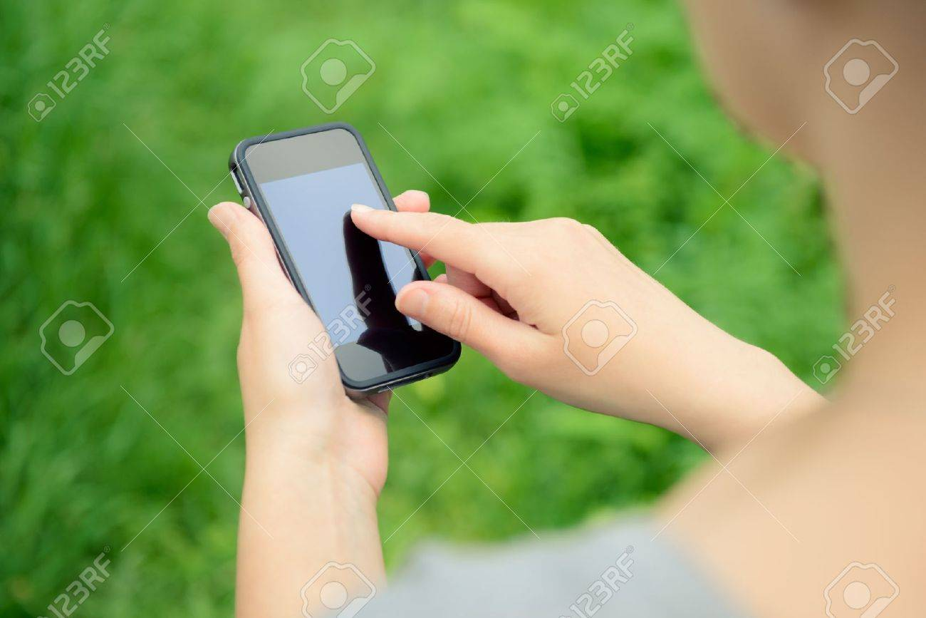 Woman using mobile smart phone in the park Stock Photo - 13847719