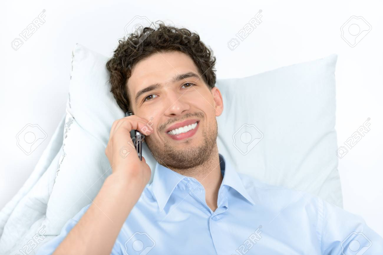 Young handsome man with modern mobile phone  Studio shot Stock Photo - 15038120