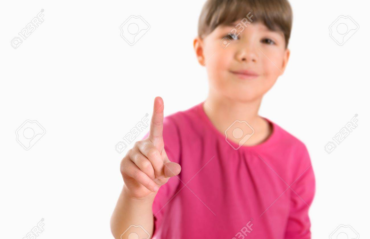 Little girl  5-6 year  touching virtual screen  Isolated on white Stock Photo - 16248327