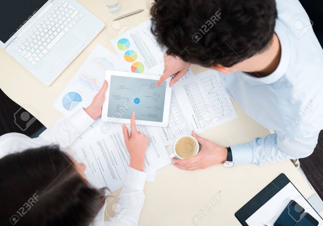 Business team working on a new business plan with modern digital computer. Top view shot. Stock Photo - 16829247