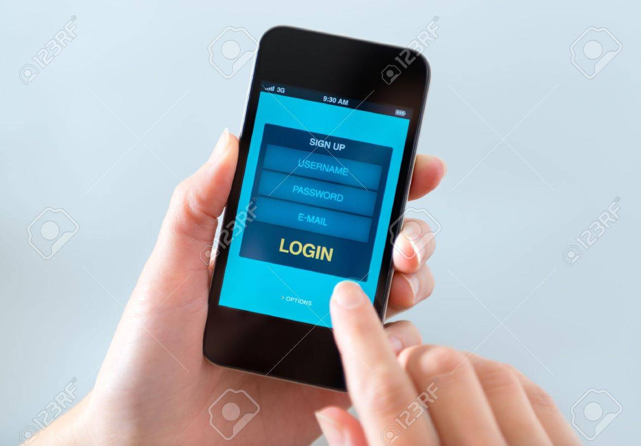Woman holding and touching on modern mobile smartphone with login form on a screen. Stock Photo - 17158136