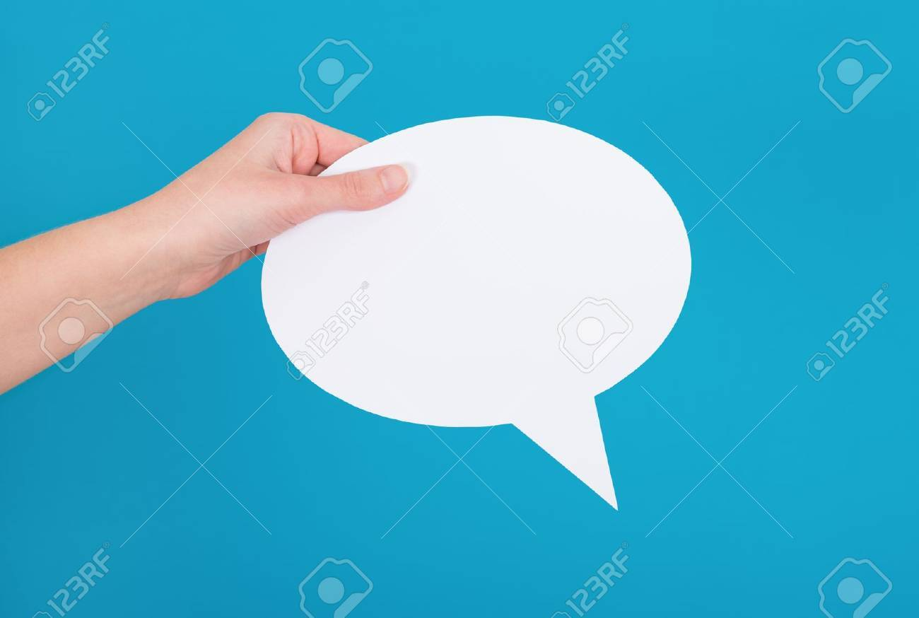 Hand holding an empty speech bubble on blue background Stock Photo - 18463445