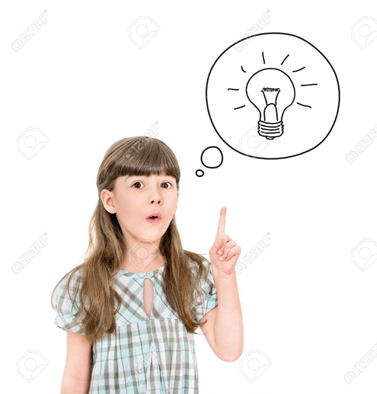 Clever little girl with a bright idea symbol pointing upwards with her finger to gain attention  Isolated on white Stock Photo - 18737649