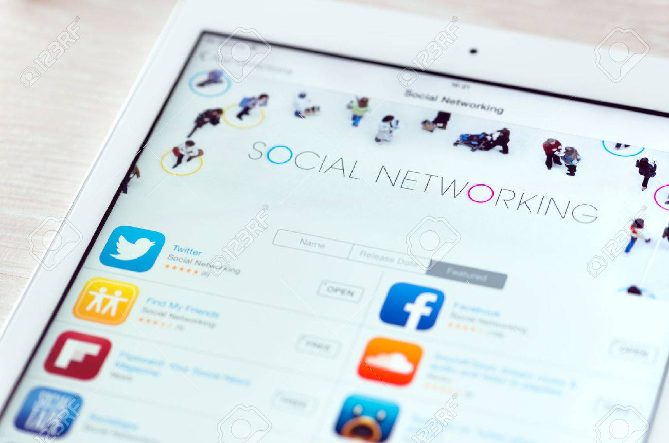 KIEV, UKRAINE - JUNE 05, 2014: Brand new modern white Apple iPad Air with featured social networking apps in App Store collection. App Store is a digital distribution service for mobile apps on iOS platform, developed by Apple Inc. Apple iPad Air is devel Stock Photo - 29327647